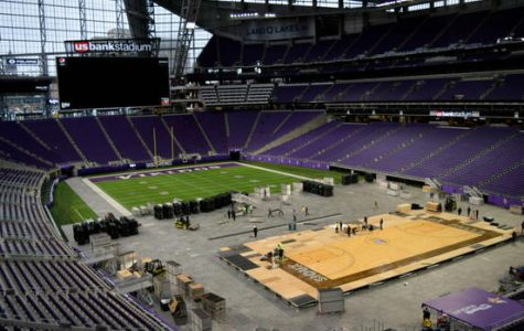 Workers install a basketball court at U.S. Bank Stadium on Tuesday, Nov. 27, 2018, where the Vikings' venue will hold its first basketball games. The court has been borrowed from the Denny Sanford Premier Center in Sioux Falls, S.D. The Gophers are scheduled to play Oklahoma State there at 9 p.m. Friday night. (Courtesy of SMG / U.S. Bank Stadium)