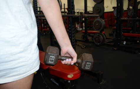 Pictured above is athlete Abby Capulong training in the weight room.