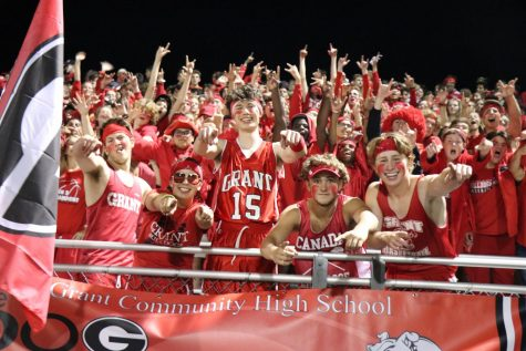 Super-fans representing Grant at one of the High School