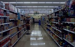 Pictured above is a deserted aisle within a dim grocery store. Photo credits to Creative Commons.